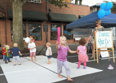Kids hit the street dance floor outside Illumination Learning Studio.
