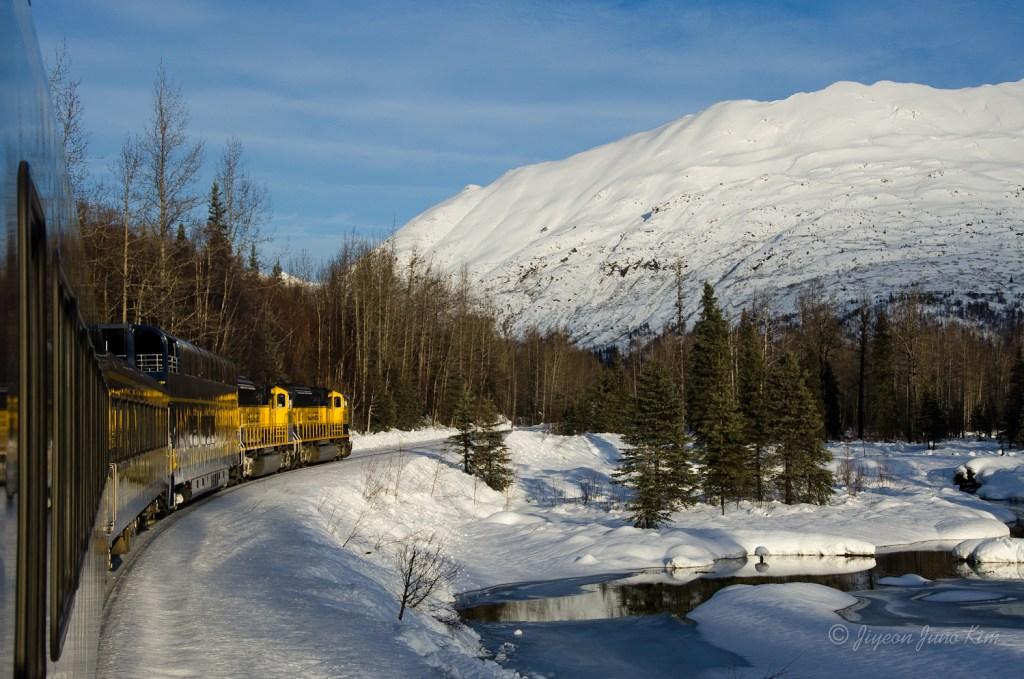 Alaska Railroad Aurora Winter Train goes through beautiful mountains
