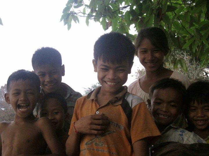 Cambodian children laugh heartily