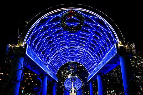 under the blue lights at christopher columbus park trellis lighting s