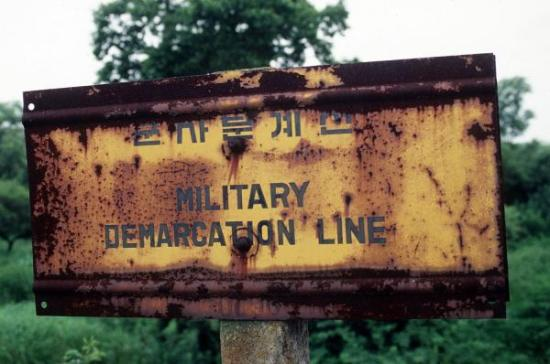Military Demarcation Line sign between North and South Korea