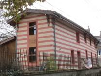 ITE chaux chanvre sur maison brique Toulouse, enduit de finition et badigeon