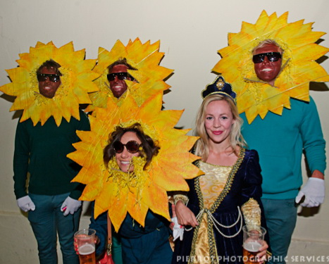 Cromer carnival fancy dress girl surrounded by  sunflowers