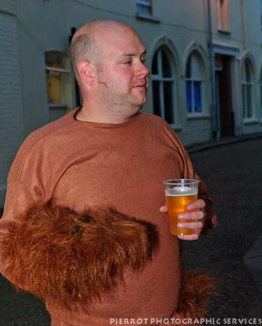 Cromer carnival fancy dress man holding his wig
