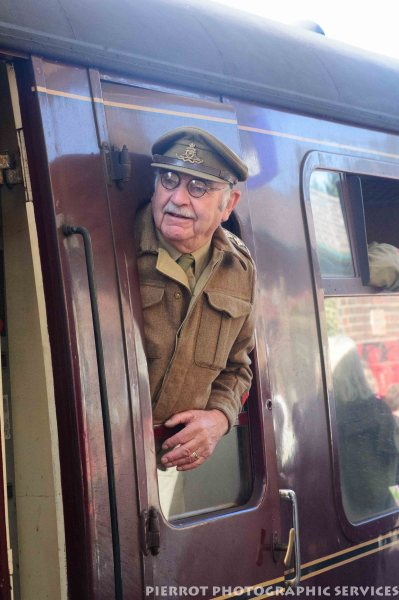 Army captain looking out of train at the 1940s weekend at Sheringham