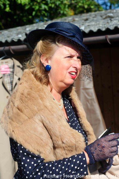 Woman in period hat and fox fur stole at the 1940s weekend in Sheringham