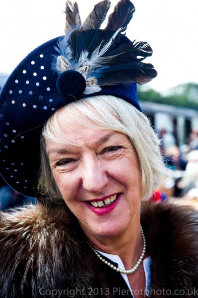 Mature woman with feather in her hat