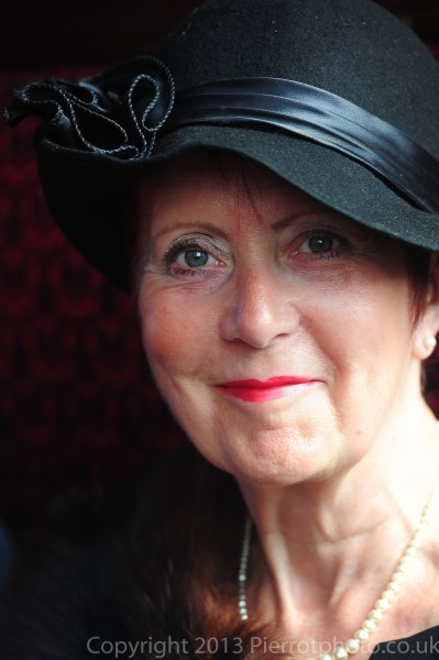 Attractive mature woman in blue hat