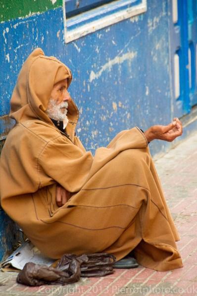 Moroccan beggar in the medina of Essaouira, Morocco