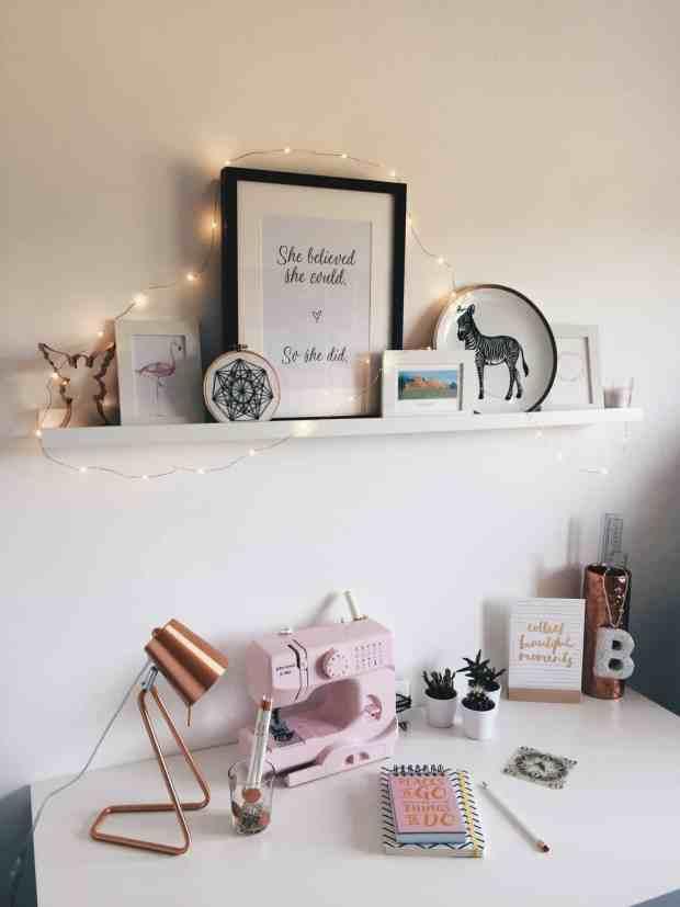 White desk with white shelf and copper accessories