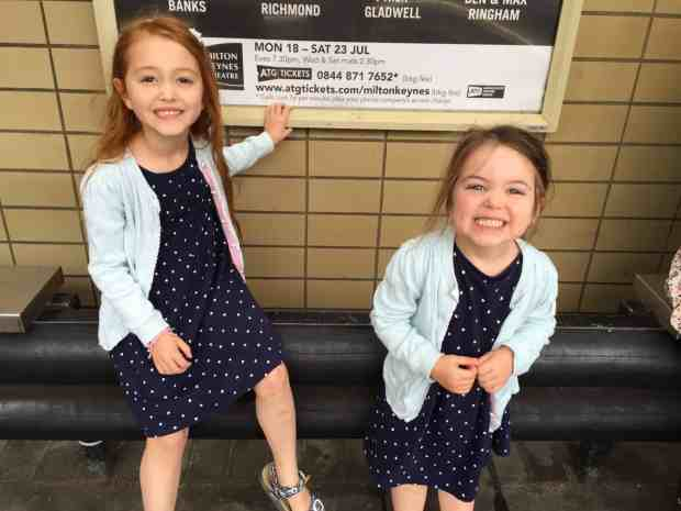Excited girls at the train station