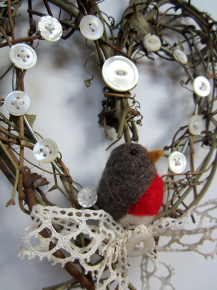 needlefelt robin in a twig heart