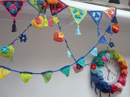 crochet bunting in Planet Penny rainbow colours