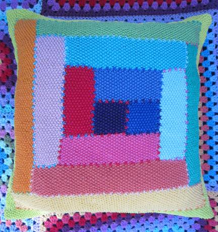 Log Cabin knitted cushion