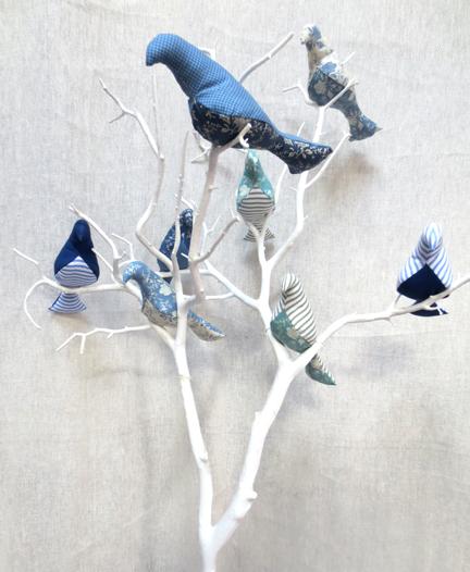 blue fabric birds in tree