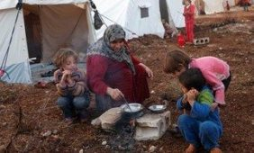 A refugee cooks in font of her tent in the refugee camp © Freedom House on Flickr, used under Creative Commons License.