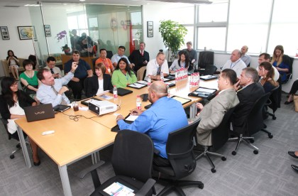 CDFA Secretary Karen Ross (second from left, at table, facing camera) at a briefing at the California-China Office of Trade in Shanghai. To her right is Keith Schneller, director of the US Agricultural Trade Office in Shanghai.