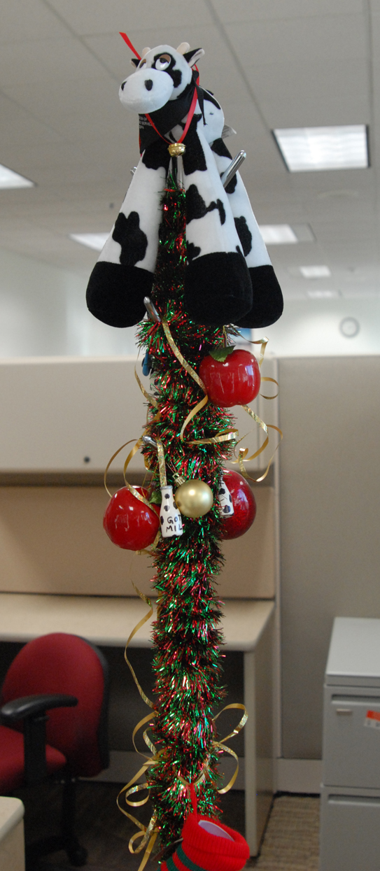 Can't fit a tree in your cubicle over at the dairy  office? No problem. Decorate the coat rack instead!