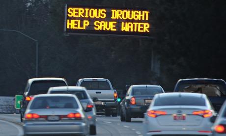 California drought : A sign warns motorists to save water