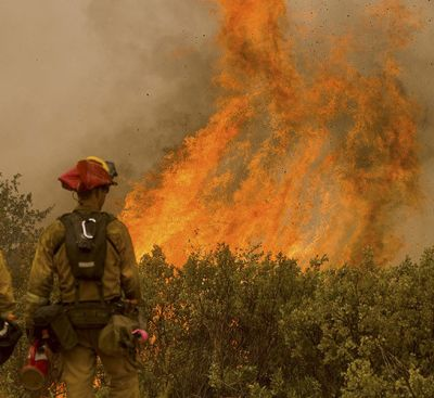 Firefighters monitor a backfire as they try to contain the Butte fire near San Andreas