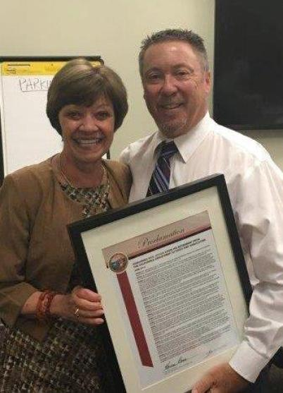 Secretary Ross with CDFA Director of Inspection Services Rick Jensen, who is retiring this week after 41 years of service to the Department. Secretary Ross commemorated Jensen's retirement with a proclamation congratulating him for his distinguished career.