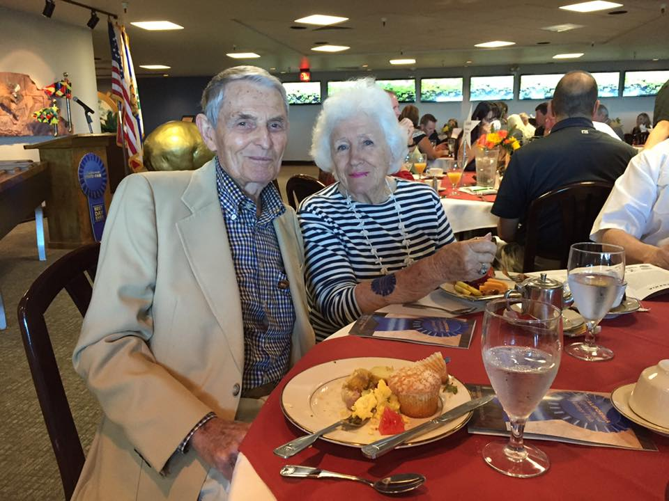 Former CDFA director Richard Rominger and his wife, Evelyne, at this morning's Ag Heritage breakfast. Evelyne is sporting a temporary blue ribbon tattoo supplied by the California State Fair.