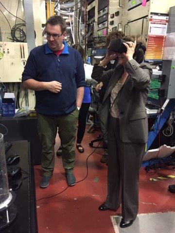 Secretary Ross wears a virtual reality headset to view the inside of a grapevine captured by X-Ray.