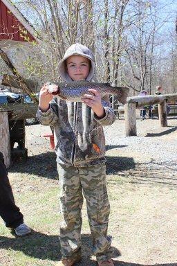 "Sam Niznik, age 9 of Pleasant Valley a 16"" trout."
