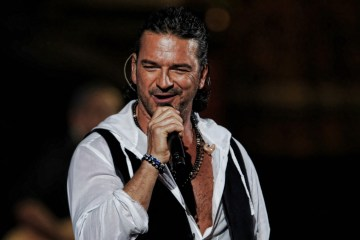 Guatemala's singer Ricardo Arjona performs during the Vina del Mar International Song Festival on February 26, 2010 in Vina del Mar, Chile. AFP PHOTO/MARTIN BERNETTI (Photo credit should read MARTIN BERNETTI/AFP/Getty Images)
