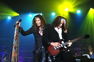 NEW YORK, NY - JUNE 13:  Steven Tyler and Joe Perry of Aerosmith perform at the Songwriters Hall of Fame 44th Annual Induction and Awards Dinner at the New York Marriott Marquis on June 13, 2013 in New York City.  (Photo by Larry Busacca/Getty Images for Songwriters Hall Of Fame)