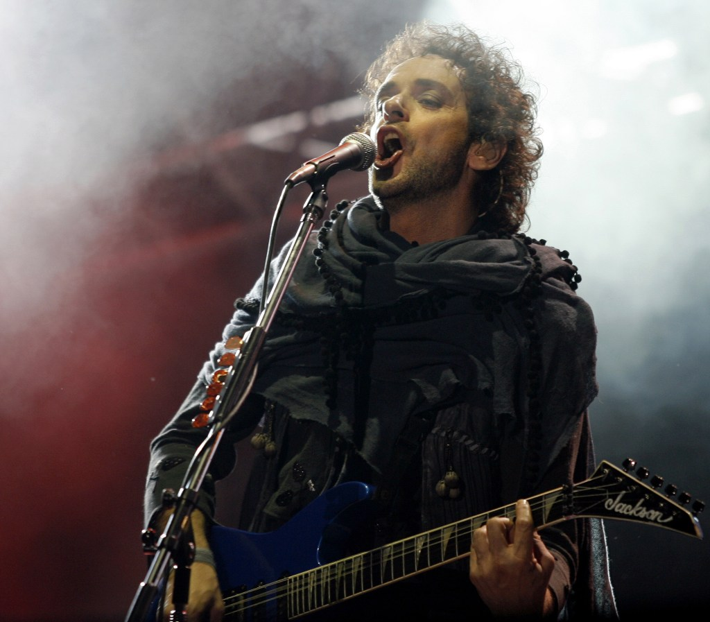 "Gustavo Cerati of Argentina's rock group Soda Stereo performs during the first concert of the 2007 Tour ""Me Veras volver"" at the Monumental stadium in Buenos Aires, October 19th, 2007. Soda Stereo began tonight a twenty-one-concert tour across the American continent.  AFP PHOTO/Juan MABROMATA ARGENTINA-MUSIC-SODA STEREO ARGENTINA-MUSIC-SODA STEREO ARGENTINA-MUSIC-SODA STEREO ARGENTINA-MUSIC-SODA STEREO"