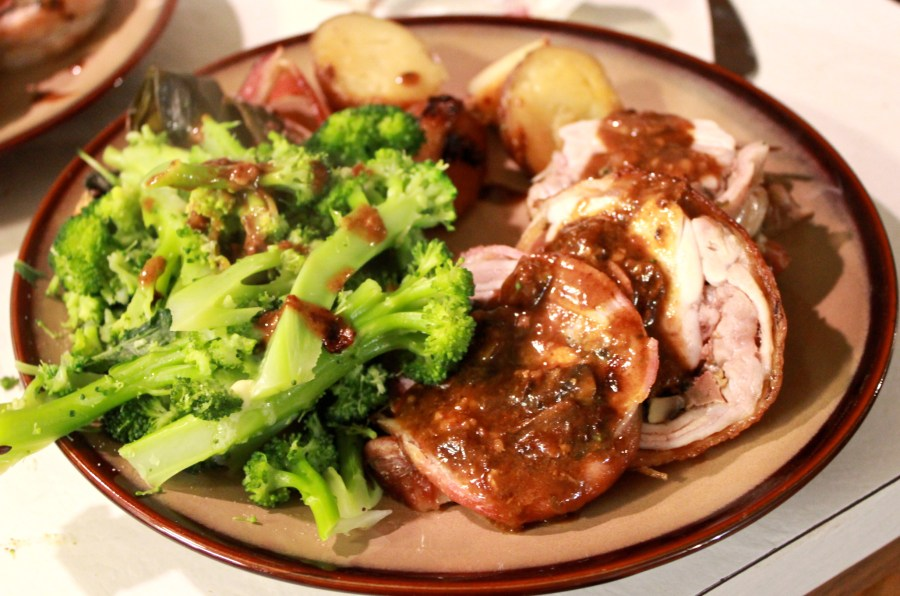 Christmas dinner: Bacon wrapped rabbit roast, stuffed with spinach, mushrooms and other delicious things