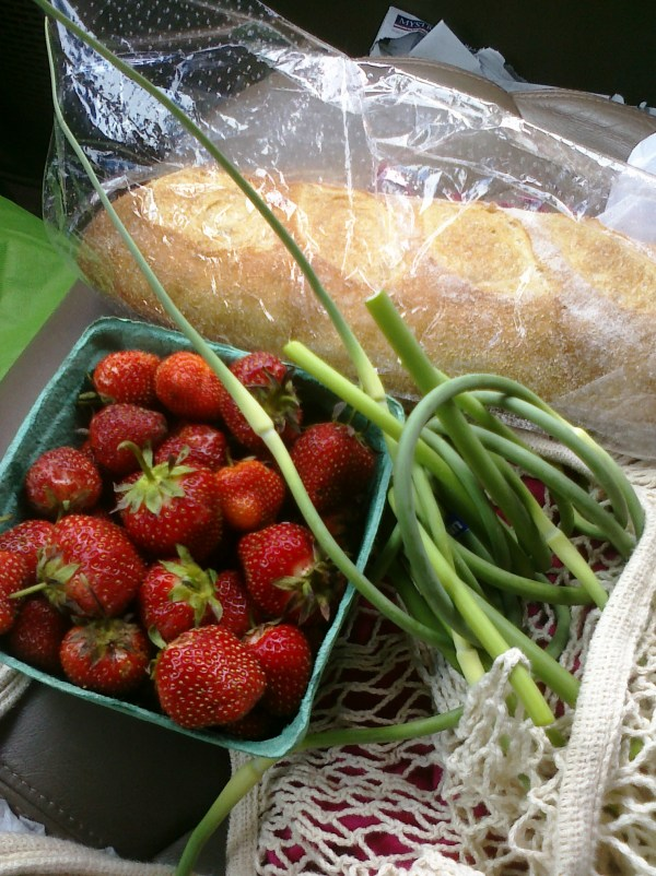 cell phone photo of farmers' market strawberries