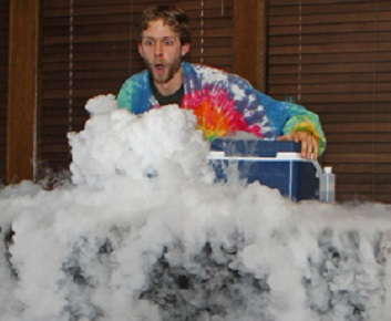 """Washington, CT-113013MK20 COUNTRYLIFE Ken Nicholas from Sciencetellers creates a fog bank with dry ice at the finale of """"Dragons and Dreams,"""" a family program put on by the Sciencetellers at Gunn Memorial Library on Saturday afternoon. The presentation was a fairytale brought to life with exploding bottles, dry ice, popping bubbles and other fun interactive experiments.  Michael Kabelka / Republican-American"""
