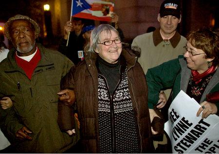 Lynne F. Stewart with husband, Ralph Poynter on left, before surrendering on Thursday. (John Marshall Mantel for The New York Times)