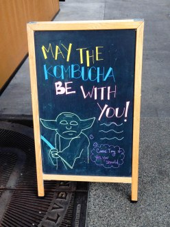 Chalkboard art of Star Wars Yoda and Kombucha outside Cafe Vida in Culver City, CA during Christmastime in California