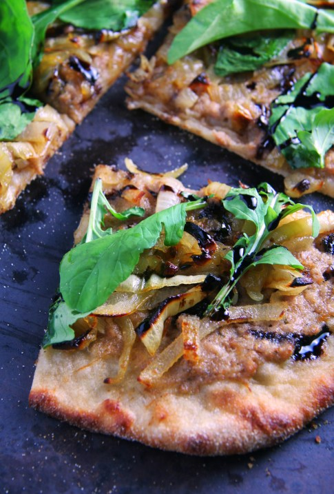 Duck Rillette Pizza with Caramelized Onions, Balsamic Reduction and Fresh Arugula
