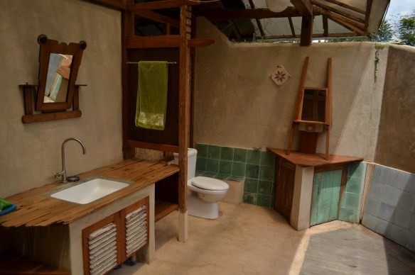 The sink and toilet of the Limas Gede's indoor outdoor bathroom