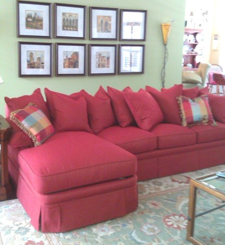 This scatterback sectional has two pieces: a full-length sofa and chaise end.