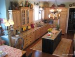 The warm wood kitchen has Soumack carpet runners