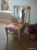 Our client gave a side chair a crafty re-do with paint, tassels and toile