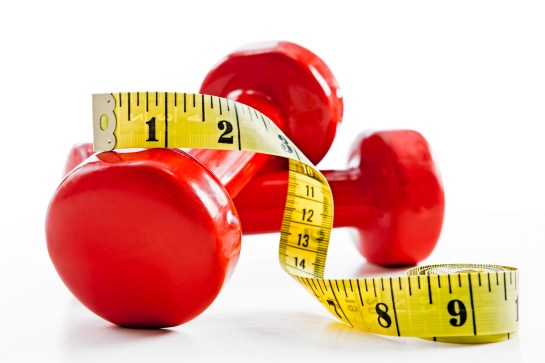 Red weights with measuring tape