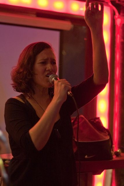 Amina from Madu performing at the fundraiser gig. Photo by Paul Reynolds
