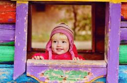 Little Girl in Colourful Playhouse