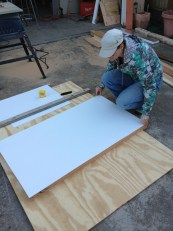Cutting the plastic sheeting.