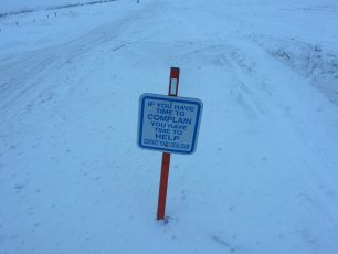 join a snowmobile club trail sign