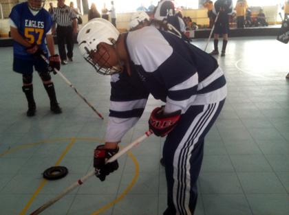 Special Olympics athlete Jose Castrejon demonstrates his Floor Hockey skills.