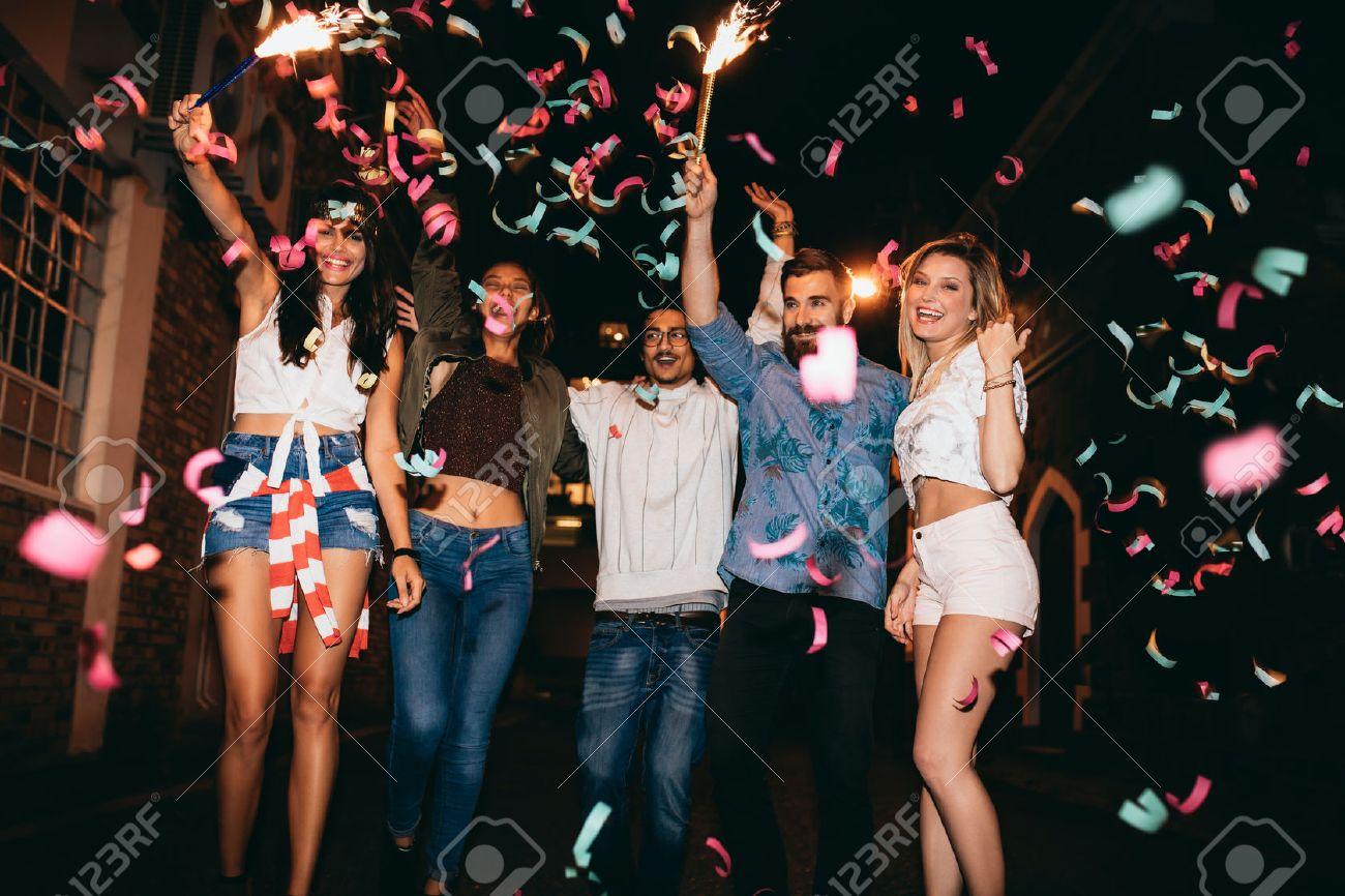 Group Of Young People Having A Party  Outdoors  Multiracial Young     Group of young people having a party  outdoors  Multiracial young men and  women celebrating