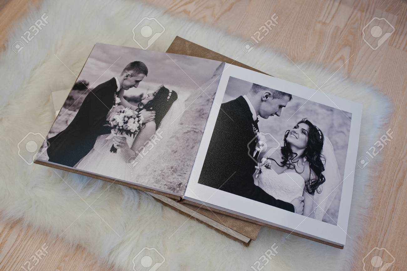 Splendiferous Wedding Photobook Or Wedding Album At Carpet On Wooden Wedding Photo Book Templates Wedding Photo Book Maker Wedding Photobook Or Wedding Album At Carpet On Wooden Photo Pages Pages wedding photo Wedding Photo Book
