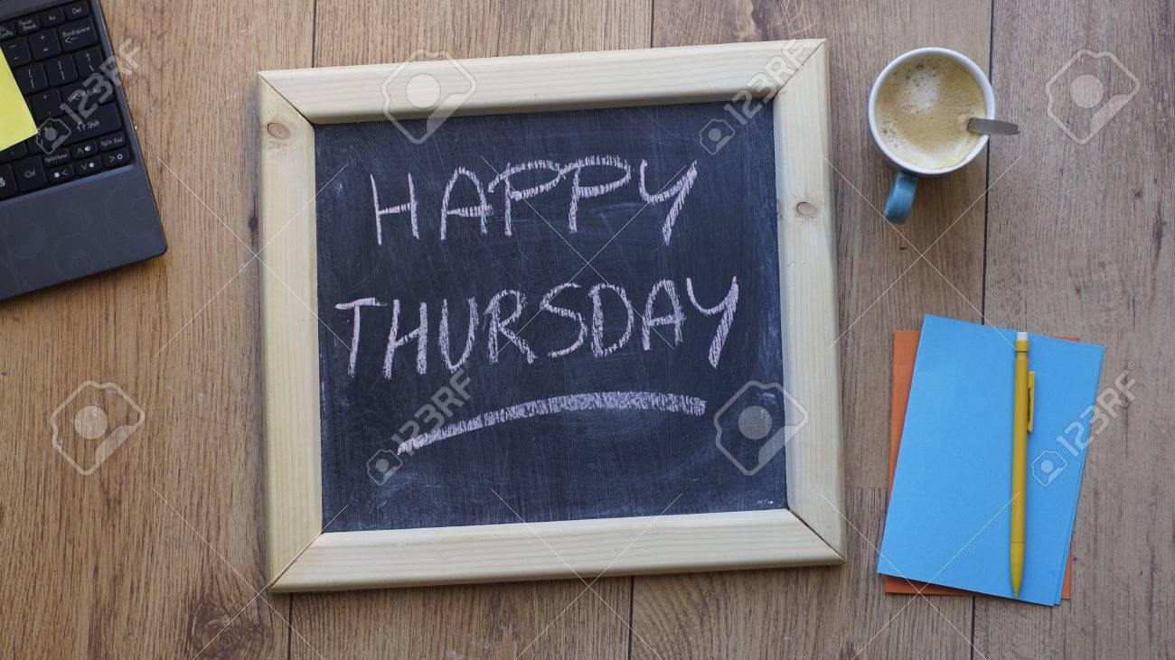 B Happy Thursday Written On A Chalkboard At The Office Stock Photo  36976177